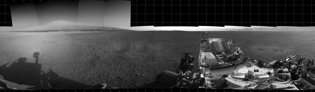 Description of . FILE - This Aug. 18, 2012 image provided by NASA shows the Curiosity rover's landing site and Mount Sharp in the distance. (AP Photo/NASA)