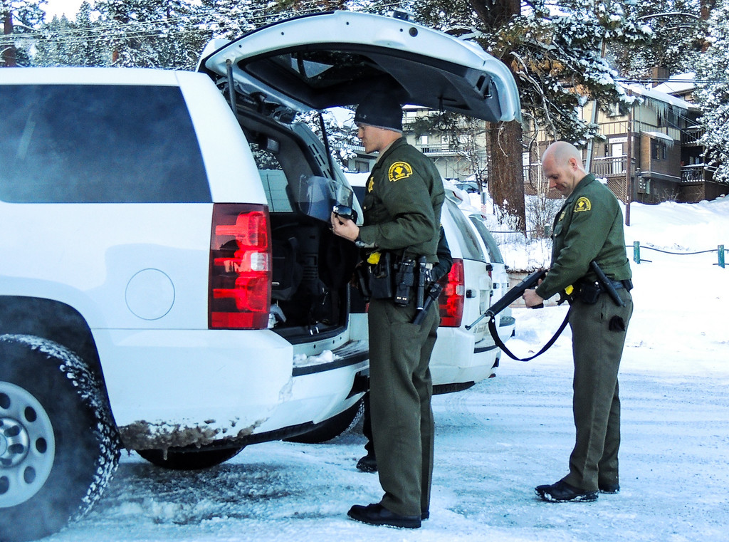 Description of . A sheriff\'s deputies pack up and prepare to leave the command post at Bear Mountain Resort at start of day four in the search for fugitive ex-cop Christopher Dorner in Big Bear on Sunday, Feb. 10, 2013. (Rachel Luna / Staff Photographer)