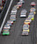 NASCAR driver Danica Patrick (front L) leads the field during the NASCAR Sprint Cup Series Daytona 500 race at the Daytona International Speedway in Daytona Beach, Florida February 24, 2013. REUTERS/Pierre Ducharme