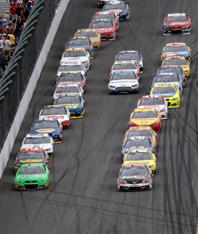 Description of . NASCAR driver Danica Patrick (front L) leads the field during the NASCAR Sprint Cup Series Daytona 500 race at the Daytona International Speedway in Daytona Beach, Florida February 24, 2013. REUTERS/Pierre Ducharme