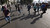 Protesters, who oppose Egyptian President Mohamed Mursi, flee from riot police during clashes along Qasr Al Nil bridge, which leads to Tahrir Square in Cairo March 9, 2013.