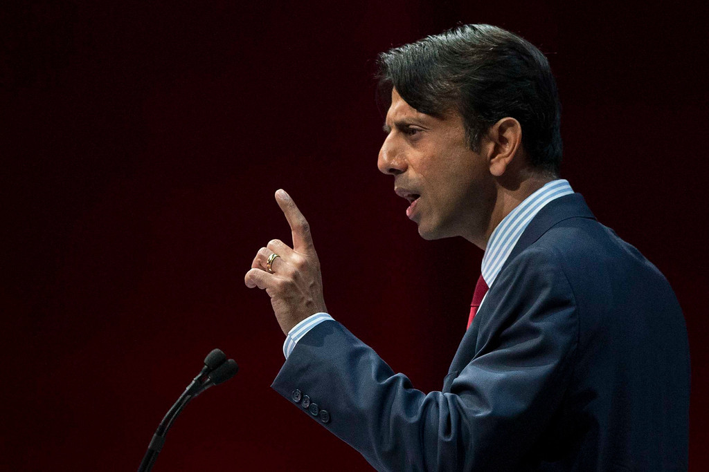 Description of . Louisiana Governor Bobby Jindal speaks at the NRA-ILA Leadership Forum at the George R. Brown Convention Center, the site for the National Rifle Association's annual meeting in Houston, Texas May 3, 2013. It is time to stop demonizing all law-abiding gun owners because of violent acts committed by a few criminals, National Rifle Association leaders and political allies said on Friday at its first convention since the Connecticut school massacre. Organizers expect some 70,000 attendees at the 142nd NRA Annual Meetings & Exhibits in Houston, which began on Friday and continues through Sunday. REUTERS/Adrees Latif  (UNITED STATES - Tags: POLITICS)