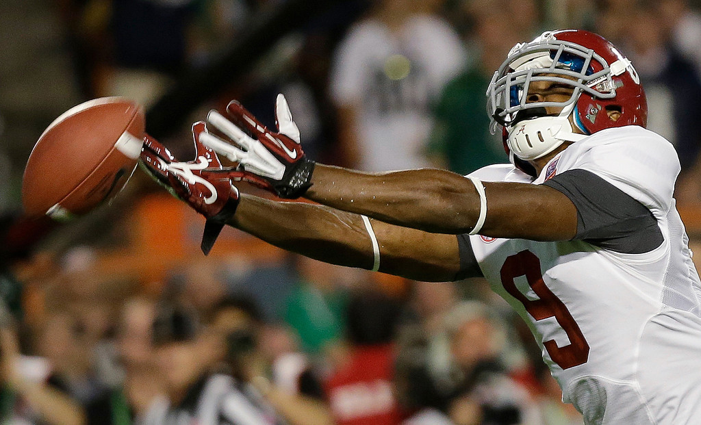 Description of . Alabama wide receiver Amari Cooper can't quite come up with a reception during the first half of the BCS National Championship college football game against Notre Dame Monday, Jan. 7, 2013, in Miami. (AP Photo/David J. Phillip)