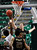 Texas State's Matt Staff (21) attempts to block a shot by Denver's Royce O'Neale (20) during the fist half of a Western Athletic Conference tournament NCAA college basketball game on Thursday, March 14, 2013, in Las Vegas. (AP Photo/David Becker)