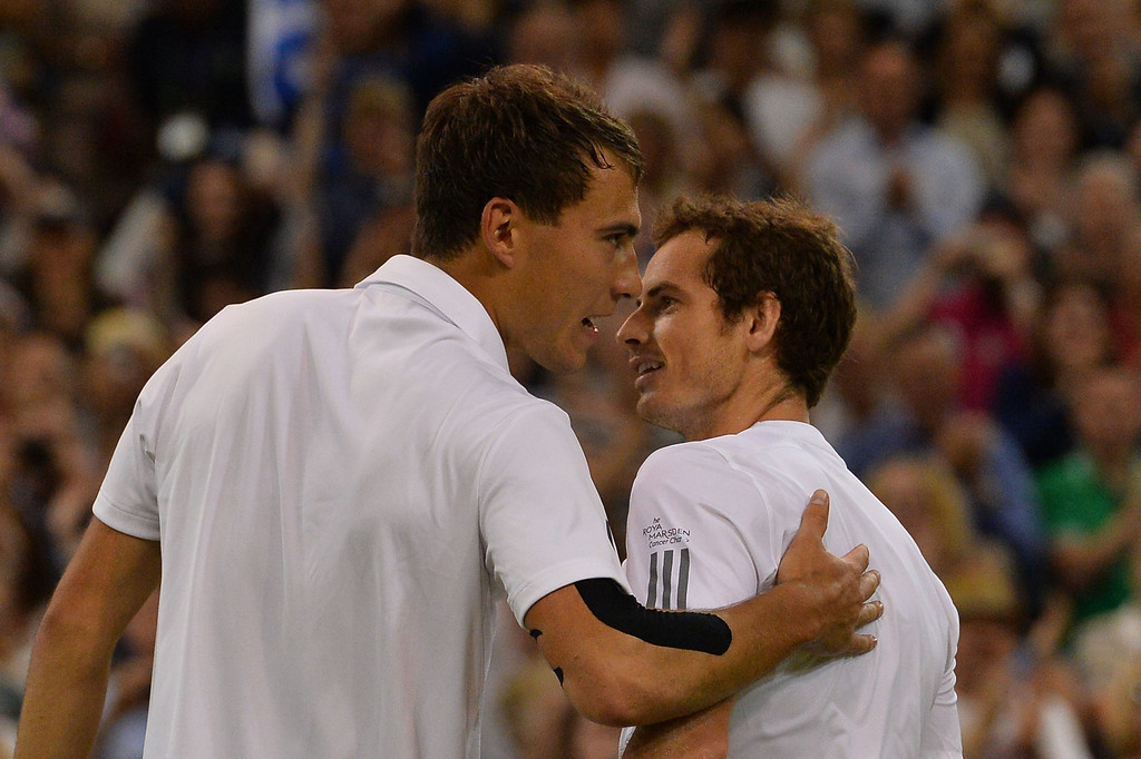 Description of . Britain\'s Andy Murray (R) shakes hands with Poland\'s Jerzy Janowicz (L) after Murray\'s victory in their men\'s singles semi-final match on day eleven of the 2013 Wimbledon Championships tennis tournament at the All England Club in Wimbledon, southwest London, on July 5, 2013. Murray won 6-7, 6-4, 6-4, 6-3. CARL COURT/AFP/Getty Images