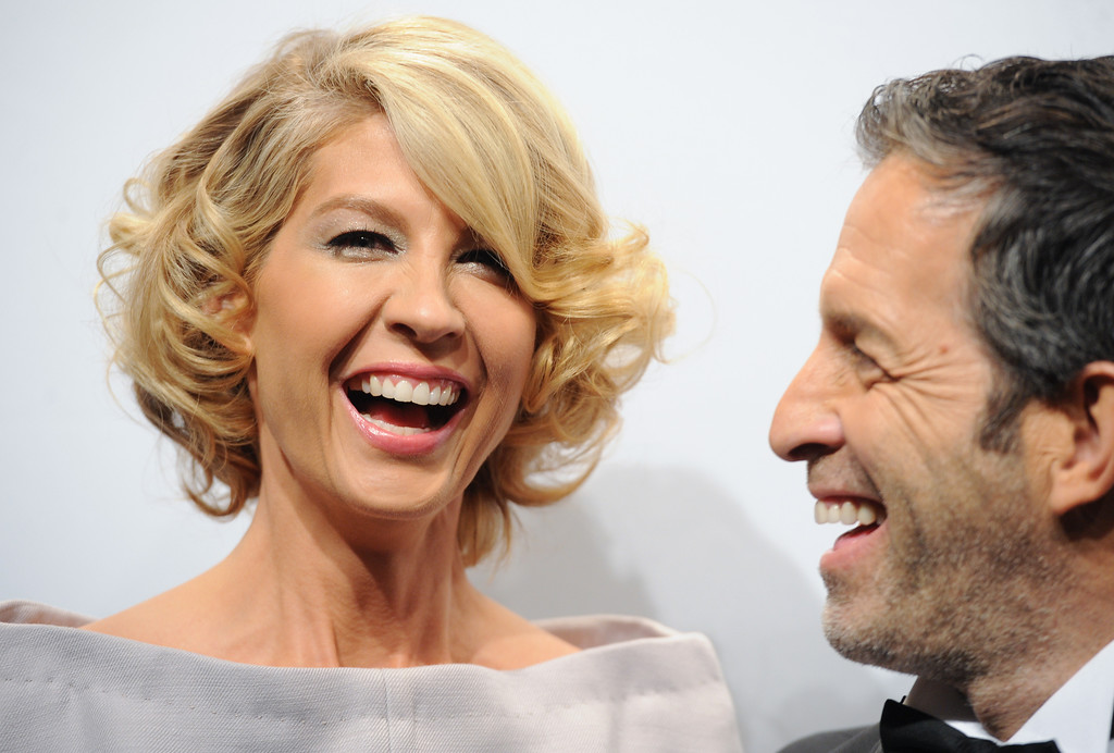 Description of . Actress Jenna Elfman and designer Kenneth Cole attend amfAR's New York gala at Cipriani Wall Street on Wednesday, Feb. 6, 2013 in New York. (Photo by Evan Agostini/Invision/AP)