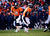 Denver Broncos quarterback Peyton Manning (18) hands off to Denver Broncos running back Knowshon Moreno (27) in the first quarter. The Denver Broncos vs Baltimore Ravens AFC Divisional playoff game at Sports Authority Field Saturday January 12, 2013. (Photo by AAron  Ontiveroz,/The Denver Post)
