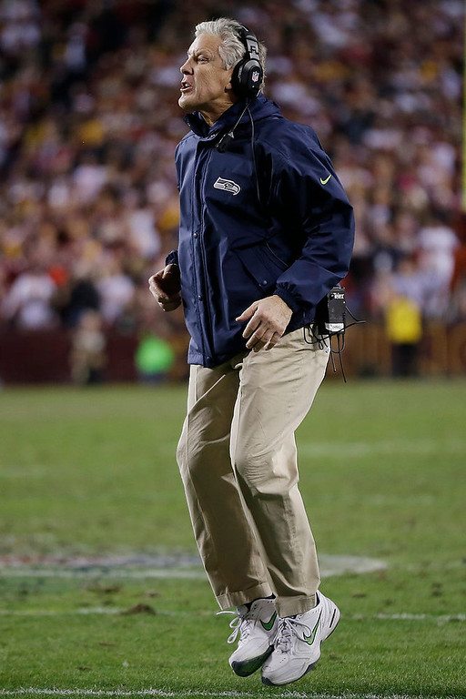 Description of . Seattle Seahawks head coach Pete Carroll reacts to a play during the first half of an NFL wild card playoff football game against the Washington Redskins in Landover, Md., Sunday, Jan. 6, 2013. (AP Photo/Matt Slocum)