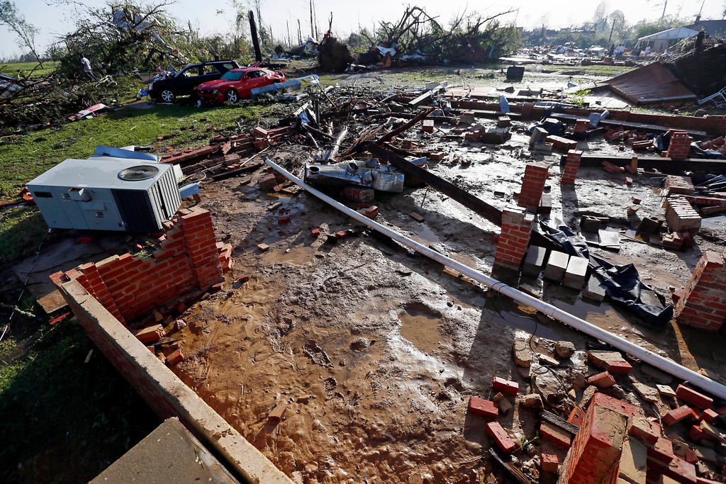 Description of . Bricks and some piping are all that remain of a house that was blown off its foundation by Monday's tornado in Louisville, Miss., Tuesday, April 29, 2014. Numerous businesses, residences and the community hospital were destroyed or heavily damaged after a tornado hit the east Mississippi community Monday. Louisville is the county seat and home to about 6,600 people. (AP Photo/Rogelio V. Solis)