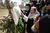 JERICHO, ISRAEL - JANUARY 18:  Greek Orthodox Patriarch Theophilos III of Jerusalem holds a white dove and prays during a traditional Epiphany ceremony at the baptismal site of Qasr el-Yahud near the West Bank city of Jericho on January 18, 2013. Thousands of Orthodox pilgrims come every year to the celebrate where it is believed that Jesus was baptised. (Photo by Abir Sultan - Pool/Getty Images)