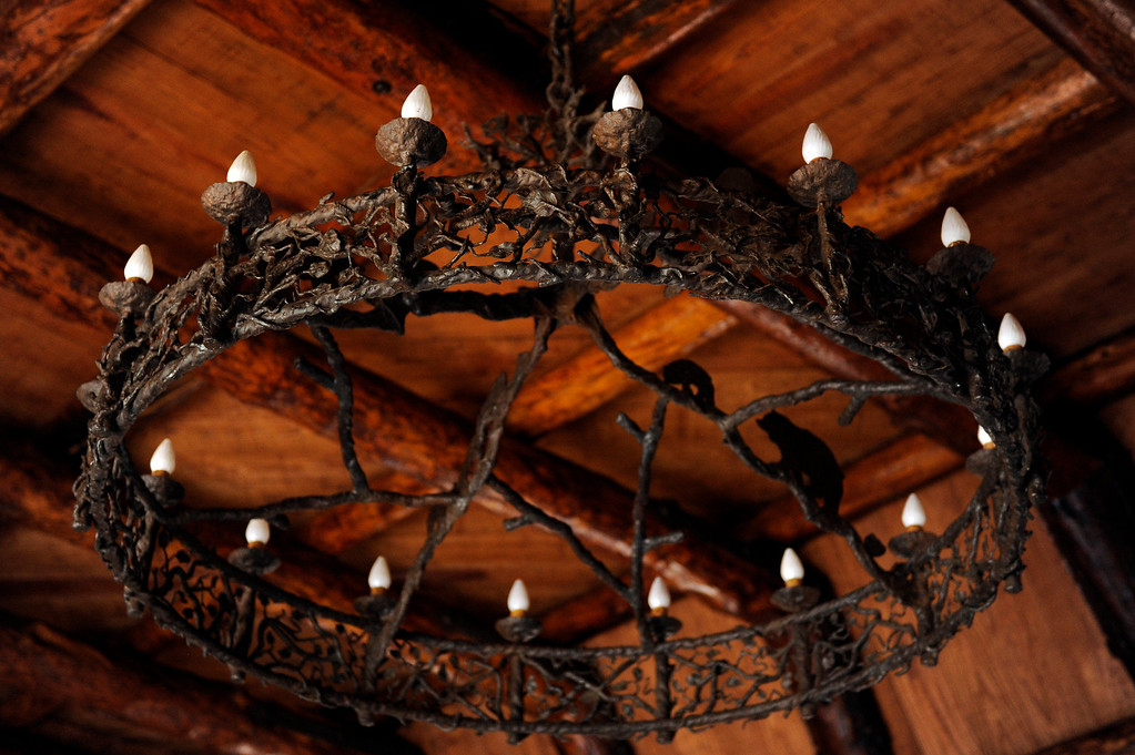 Description of . PINE, CO - APRIL 18: An original chandelier made from iron hangs in the main living room of Baehrden Lodge on April 18, 2014, in Pine, Colorado. (Photo by Anya Semenoff/The Denver Post)