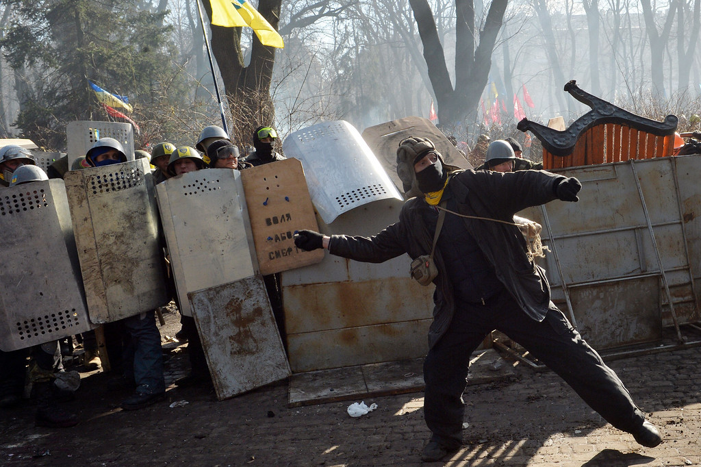Description of . Anti-government protesters clash with police in front of the Ukrainian Parliament in Kiev on February 18, 2014.  AFP PHOTO/ SERGEI SUPINSKY/AFP/Getty Images