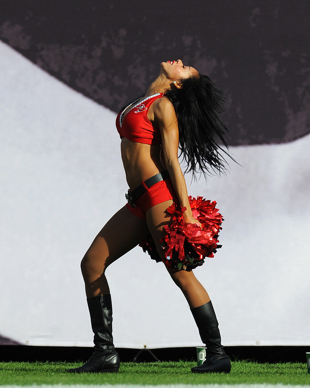 . TAMPA, FL - DECEMBER 9: A cheerleader of the Tampa Bay Buccaneers dances on the sidelines during play against the Philadelphia Eagles December 9, 2012 at Raymond James Stadium in Tampa, Florida.  The Eagles won 23 - 21. (Photo by Al Messerschmidt/Getty Images)
