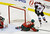 Minnesota Wild goale Niklas Backstrom, left, of Finland, looks on as Colorado Avalanche's Matt Duchene, right, scores a game-tying goal that deflected into the net off  Wild's Jared Spurgeon in the third period of an NHL hockey game on Thursday, Feb. 14, 2013, in St. Paul, Minn. The Avalanche won 4-3 in a shootout, with Duchene providing the winning goal. (AP Photo/Jim Mone)