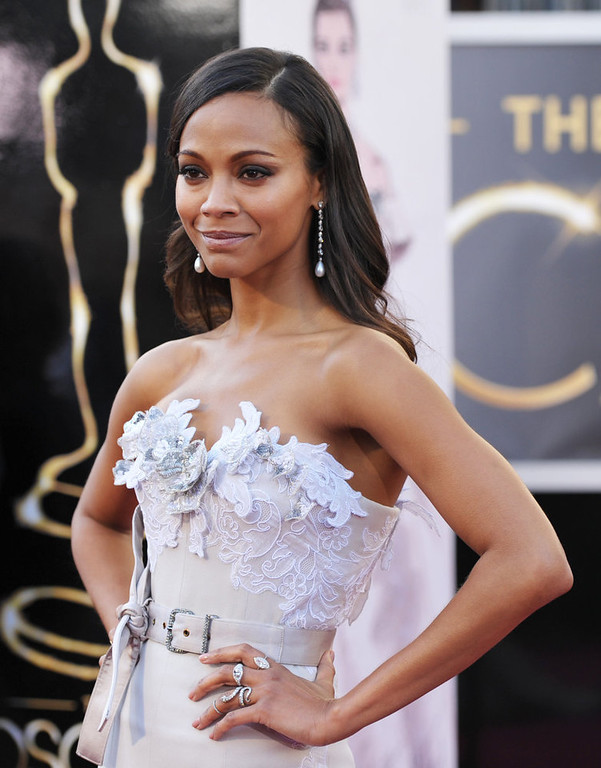 Description of . Actress Zoe Saldana arrives at the 85th Academy Awards at the Dolby Theatre on Sunday Feb. 24, 2013, in Los Angeles. (Photo by John Shearer/Invision/AP)