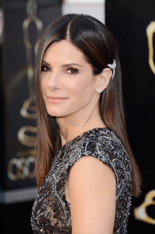 Description of . Actress Sandra Bullock arrives at the Oscars at Hollywood & Highland Center on February 24, 2013 in Hollywood, California.  (Photo by Jason Merritt/Getty Images)