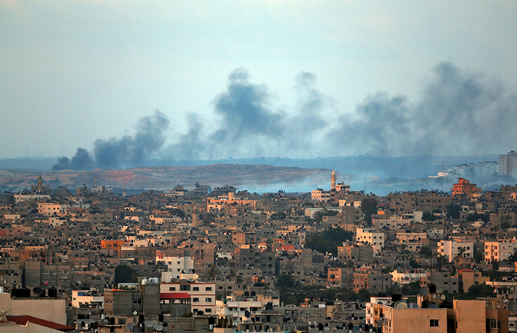 Description of . Smoke rises after an Israeli missile strike hit the northern Gaza Strip, Thursday, July 17, 2014. Palestinian health officials say that in total, over 200 Palestinians have been killed. On the Israeli side, one man has been killed since July 8.  (AP Photo/Lefteris Pitarakis)