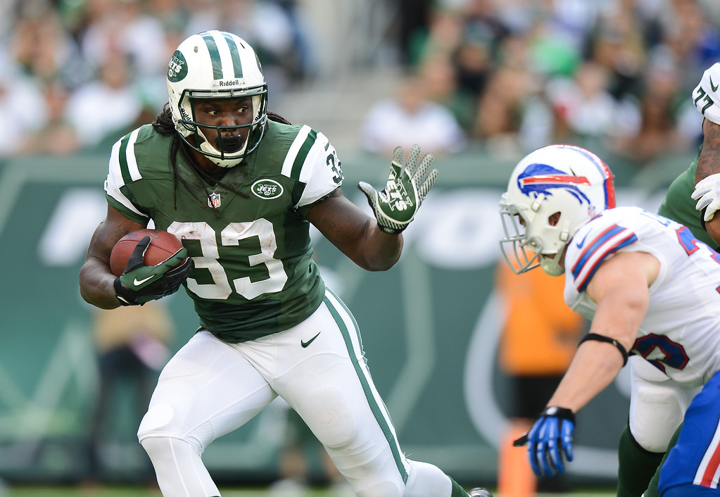 Description of . Running back Chris Ivory #33 of the New York Jets carries the ball in the 1st half of the Jets game against the Buffalo Bills at MetLife Stadium on September 22, 2013 in East Rutherford, New Jersey. (Photo by Ron Antonelli/Getty Images)