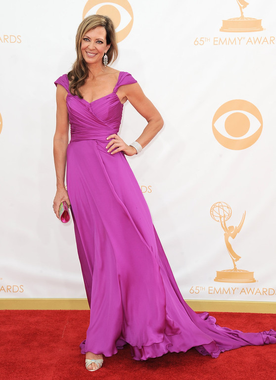 Description of . Allison Janney arrives at the 65th Primetime Emmy Awards at Nokia Theatre on Sunday Sept. 22, 2013, in Los Angeles.  (Photo by Jordan Strauss/Invision/AP)