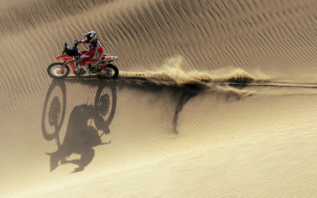 Description of . Honda's biker Javier Pizzolito of Argentina competes during the Stage 2 of the Dakar 2013 in Pisco, Peru, on January 6, 2013. The rally will take place in Peru, Argentina and Chile from January 5 to 20. FRANCK FIFE/AFP/Getty Images