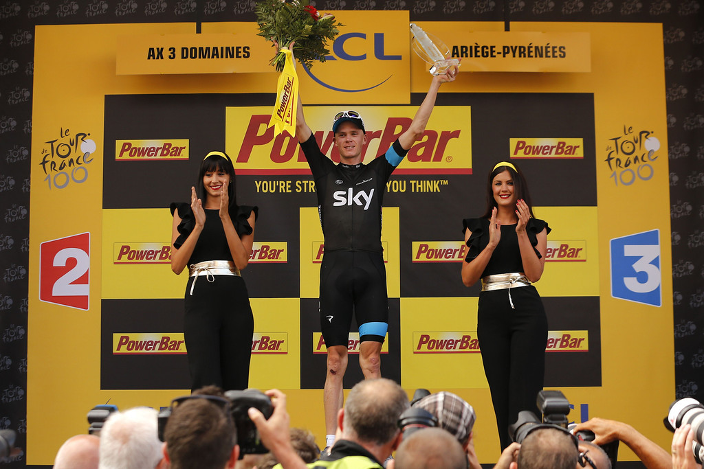 Description of . Stage winner Britain's Christopher Froome celebrates on the podium after winning the 195 km eighth stage of the 100th edition of the Tour de France cycling race on July 6, 2013 between Castres and Ax 3 Domaines, southwestern France.  JEFF PACHOUD/AFP/Getty Images