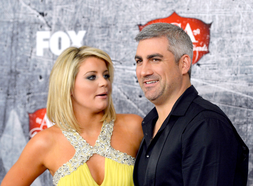 Description of . LAS VEGAS, NV - DECEMBER 10: (L-R) Singers Lauren Alaina and Taylor Hicks arrive at the 2012 American Country Awards at the Mandalay Bay Events Center on December 10, 2012 in Las Vegas, Nevada.  (Photo by Frazer Harrison/Getty Images)