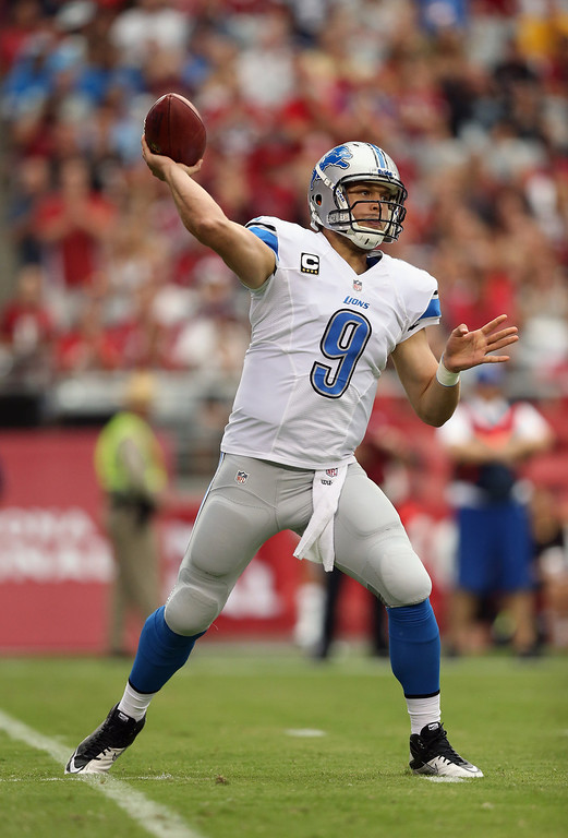 Description of . Quarterback Matthew Stafford #9 of the Detroit Lions drops back to pass against the Arizona Cardinals in the first quarter at University of Phoenix Stadium on September 15, 2013 in Glendale, Arizona.  (Photo by Jeff Gross/Getty Images)