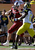 South Carolina quarterback Connor Shaw (14) prepares to stiff arm Michigan defensive back Raymon Taylor (6) during the second half of the Outback Bowl NCAA college football game  Tuesday, Jan. 1, 2013, in Tampa, Fla. South Carolina won the game 33-28. (AP Photo/Chris O'Meara)