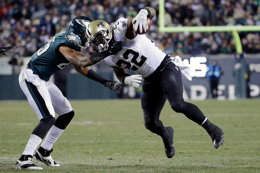 . New Orleans Saints\' Mark Ingram (22) tries to break free of Philadelphia Eagles\' Cary Williams during the second half of an NFL wild-card playoff football game, Saturday, Jan. 4, 2014, in Philadelphia. (AP Photo/Matt Rourke)