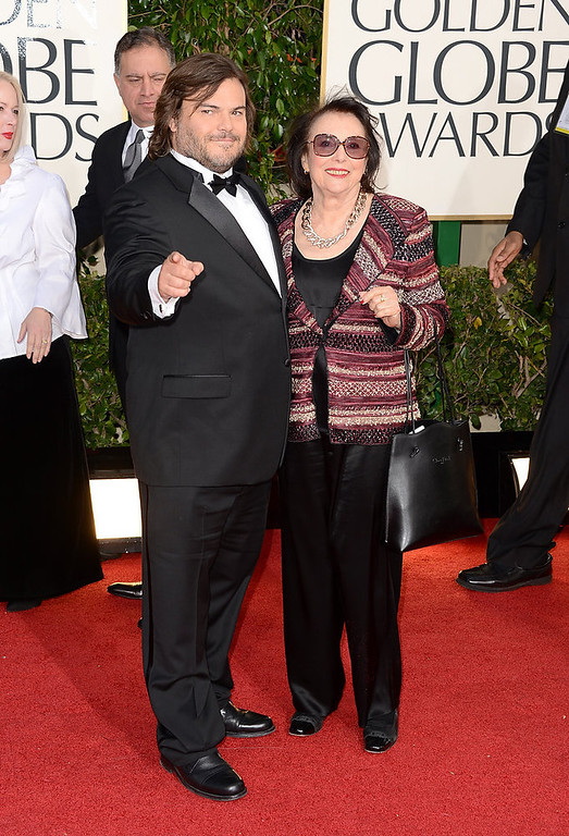 Description of . Actor Jack Black (L) and guest arrive at the 70th Annual Golden Globe Awards held at The Beverly Hilton Hotel on January 13, 2013 in Beverly Hills, California.  (Photo by Jason Merritt/Getty Images)