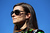 Danica Patrick, driver of the #10 GoDaddy.com Chevrolet, looks on after qualifying for the NASCAR Sprint Cup Series Daytona 500 at Daytona International Speedway on February 17, 2013 in Daytona Beach, Florida.  (Photo by Jonathan Ferrey/Getty Images)