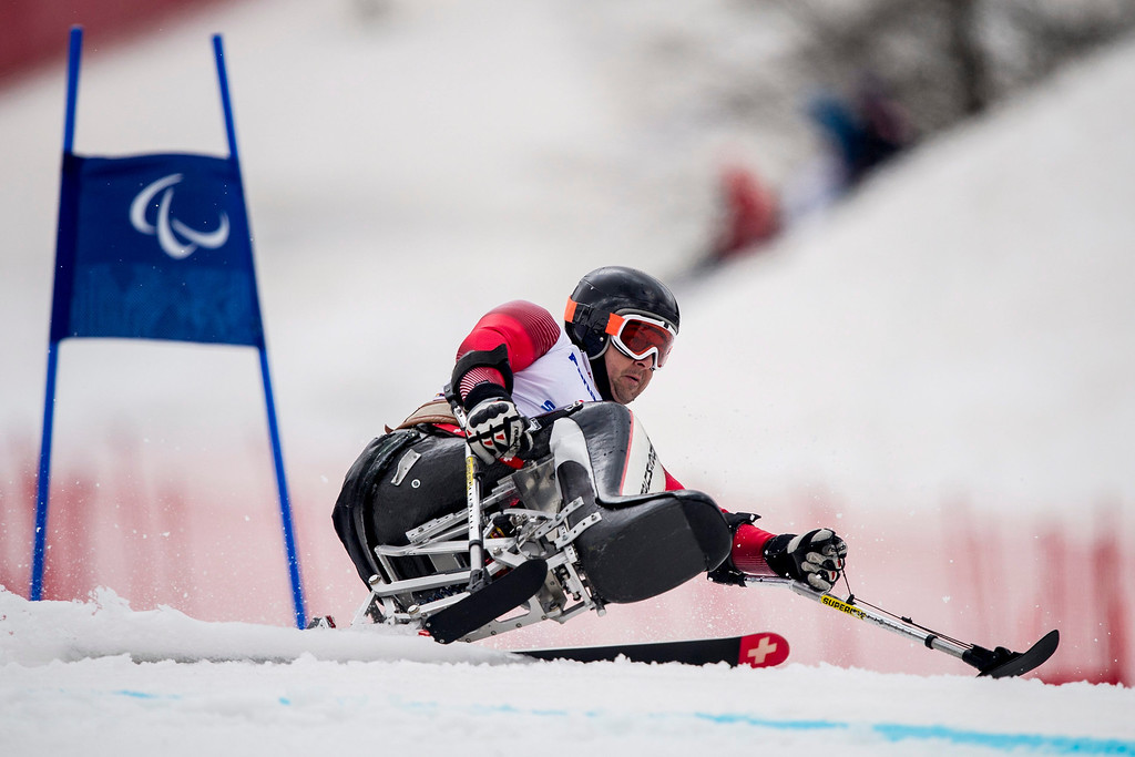 Description of . Switzerland's Maurizio Nicoli competes in the men's super-G sitting race at the Winter Paralympics 2014 Sochi in Krasnaya Polyana, Russia, on March 9, 2014.  EPA/ENNIO LEANZA
