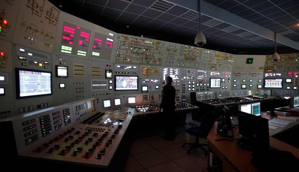 Description of . An employee works during a blackout in the central control room as part of a safety regulations exercise at Nuclear Power Plant Dukovany in Dukovany March 26, 2013.     REUTERS/David W Cerny