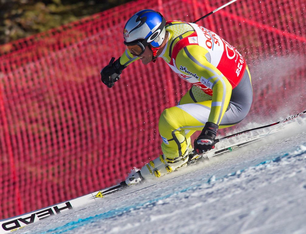 Description of . Aksel Lund Svindal of Norway, speeds down the course during the men's World Cup super-g ski race in Beaver Creek, Colo., on Saturday, Dec. 1, 2012. (AP Photo/Nathan Bilow)
