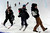 ASPEN, CO. - JANUARY 25:  Elana Chase, center, skis down the pipe after the men's ski SuperPipe finals at the 2013 Aspen X Games on Buttermilk Mountain on January 25, 2013. She coaches both David Wise and Torin Yater-Wallace the first and second place finishers. 