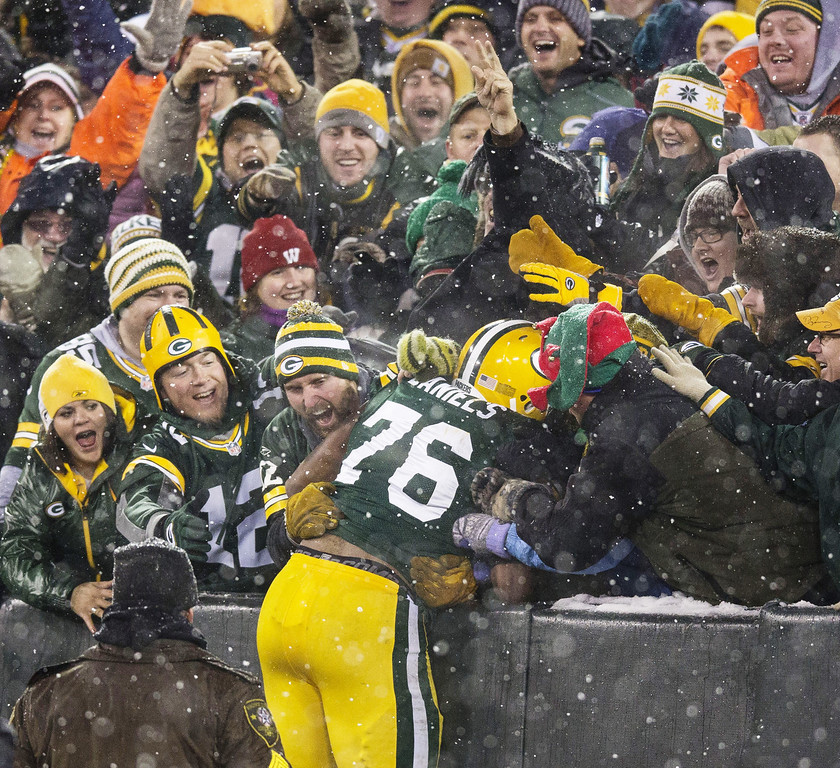 . GREEN BAY, WI - DECEMBER 9:  Mike Daniels #76 of the Green Bay Packers does a Lambeau after he scored a touchdown on a fumble recovery at Lambeau Field on December 9, 2012 in Green Bay, Wisconsin.  (Photo by Tom Lynn/Getty Images)