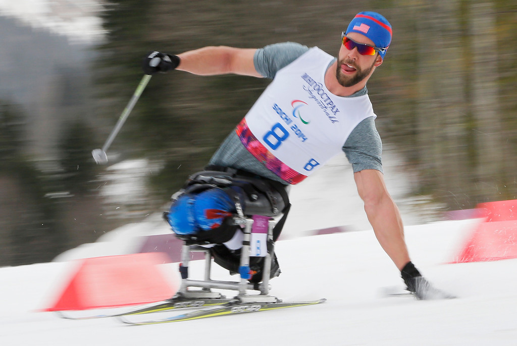 Description of . Aaron Pike of United States races during the 15km men's cross country ski, sitting event at the 2014 Winter Paralympic, Sunday, March 9, 2014, in Krasnaya Polyana, Russia. (AP Photo/Dmitry Lovetsky)