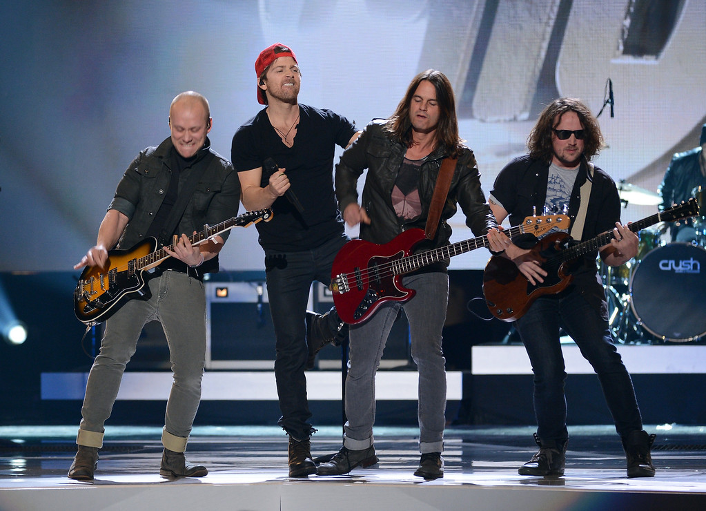 Description of . LAS VEGAS, NV - DECEMBER 10:  Singer Kip Moore (2nd L) performs with musicians onstage during the 2012 American Country Awards at the Mandalay Bay Events Center on December 10, 2012 in Las Vegas, Nevada.  (Photo by Mark Davis/Getty Images)