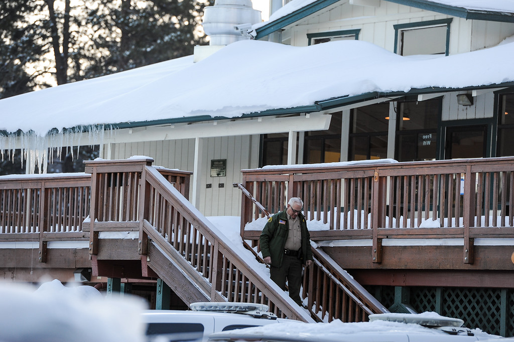 Description of . A sheriff's deputy leaves the command post at Bear Mountain Resort at start of day four in the search for fugitive ex-cop Christopher Dorner in Big Bear on Sunday, Feb. 10, 2013. (Rachel Luna / Staff Photographer)