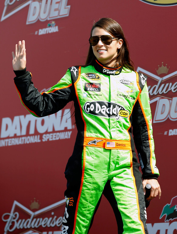 Description of . Danica Patrick waves to fans during driver introductions before the Budweiser Duel 1 NASCAR Sprint Cup Series auto race at Daytona International Speedway, Thursday, Feb. 21, 2013, in Daytona Beach, Fla. (AP Photo/Terry Renna)