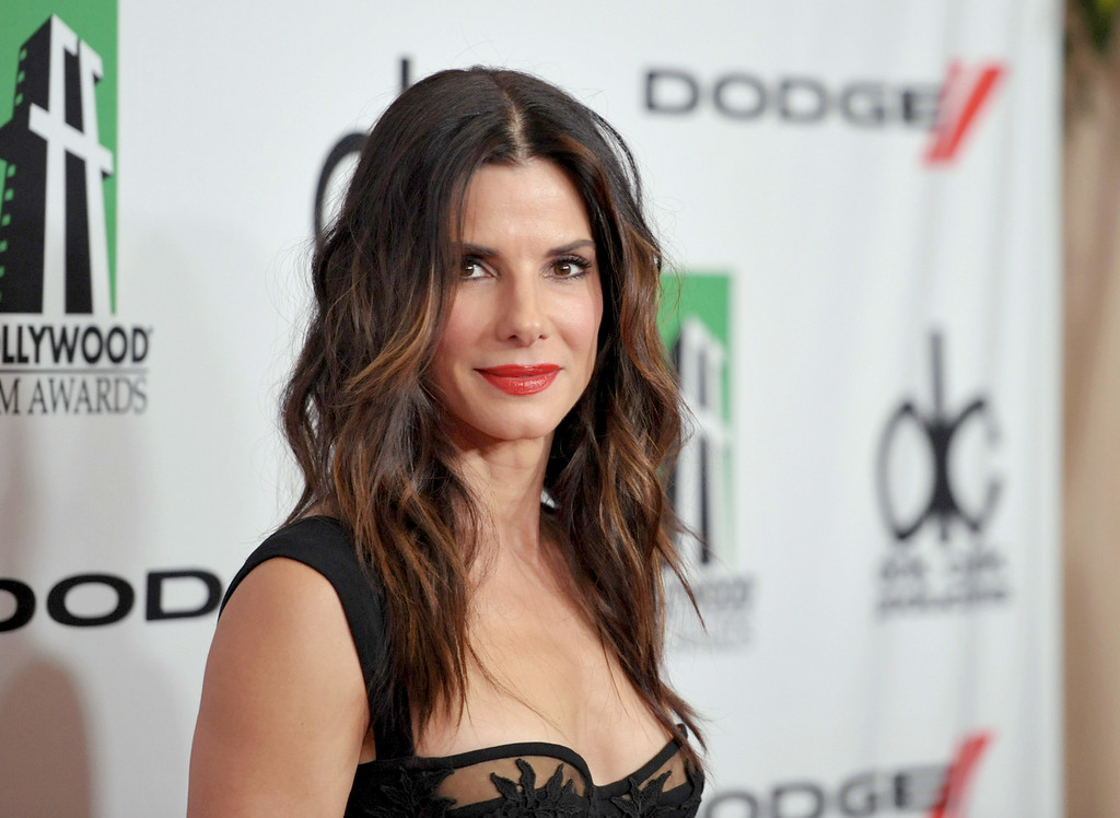 Description of . In this Oct. 21, 2013 file photo, Sandra Bullock arrives at the 17th Annual Hollywood Film Awards Gala at the Beverly Hilton Hotel in Beverly Hills, Calif.  Police arrested Joshua Corbett on June 8, 2014, inside Bullock's Los Angeles home and he was later charged with felony stalking. A search of Corbett's home turned up an arsenal of illegal weapons, including machine guns and tracer ammunition. None of the weapons were with Corbett when he broke into Bullock's home and he has pleaded not guilty to all charges. In 2010, Bullock renewed a restraining order against another man who had been stalking her since 2003 and had traveled to Wyoming to try to meet the actress after he was released from a mental hospital in Tennessee.   (Photo by John Shearer/Invision/AP, file)