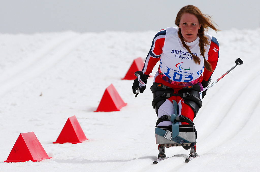 Description of . Birgit Skarstein of Norway races during the ladies 12km cross country ski, sitting event at the 2014 Winter Paralympic, Sunday, March 9, 2014, in Krasnaya Polyana, Russia. (AP Photo/Dmitry Lovetsky)