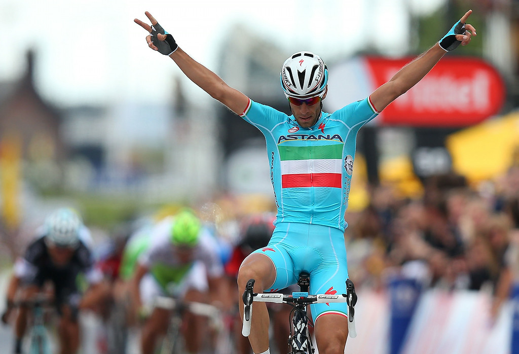 Description of . SHEFFIELD, ENGLAND - JULY 06:  Vincenzo Nibali of Italy and ProTeam Astana crosses the line to win the second stage of the 2014 Tour de France, a 201km stage between York and Sheffield, on July 6, 2014 in Sheffield, England.  (Photo by Bryn Lennon/Getty Images)