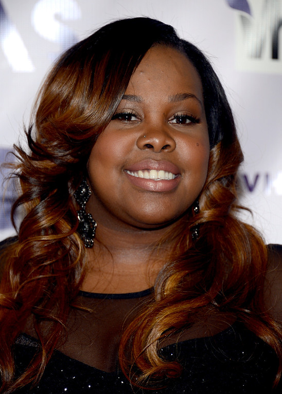 Description of . LOS ANGELES, CA - DECEMBER 16:  Actress Amber Riley attends