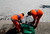 Municipal workers collect dead fish at the Rodrigo de Freitas lagoon in Rio de Janeiro, March 13, 2013. REUTERS/Sergio Moraes