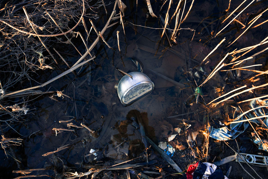 Description of . A teapot sits with other debris among reeds after being deposited in a marshy area by the storm surge of superstorm Sandy in the Staten Island borough neighborhood of Oakwood in New York, November 28, 2012.  REUTERS/Lucas Jackson