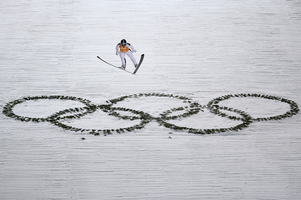 Description of . Anders Johnson of the United States jumps during the Men's Team Ski Jumping first round on day 10 of the Sochi 2014 Winter Olympics at the RusSki Gorki Ski Jumping Center on February 17, 2014 in Sochi, Russia.  (Photo by Paul Gilham/Getty Images)