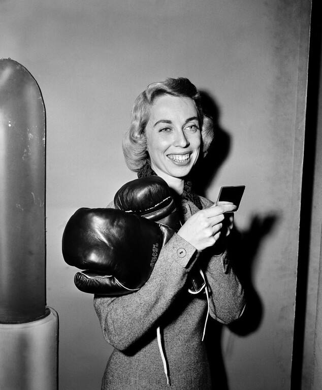 Description of . Dr. Joyce Brothers, New York City psychologist, checks her makeup after scoring another knock out on the $64000 question television quiz program in New York City, November 29, 1955. Dr. Brothers whose category is boxing, correctly answered the $32,000 question enabling her to try for the grand prize. (AP Photo)