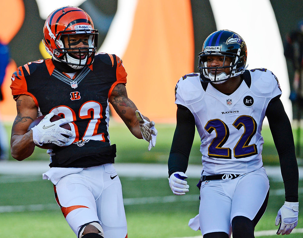 Description of . Cincinnati Bengals wide receiver Marvin Jones (82) scores against Baltimore Ravens cornerback Jimmy Smith (22) on an 11-yard pass reception in the first half of an NFL football game, Sunday, Dec. 30, 2012, in Cincinnati. (AP Photo/Michael Keating)