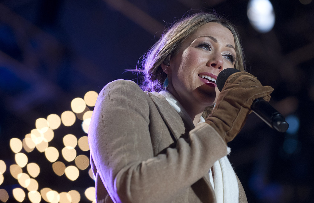 Description of . Singer Colbie Caillat performs during the National Christmas Tree Lighting on the Ellipse adjacent to the White House in Washington, DC, on December 6, 2012. The annual event, hosted by Actor Neil Patrick Harris, features US President Barack Obama and performances by Jason Mraz, Ledisi, James Taylor, Kenny